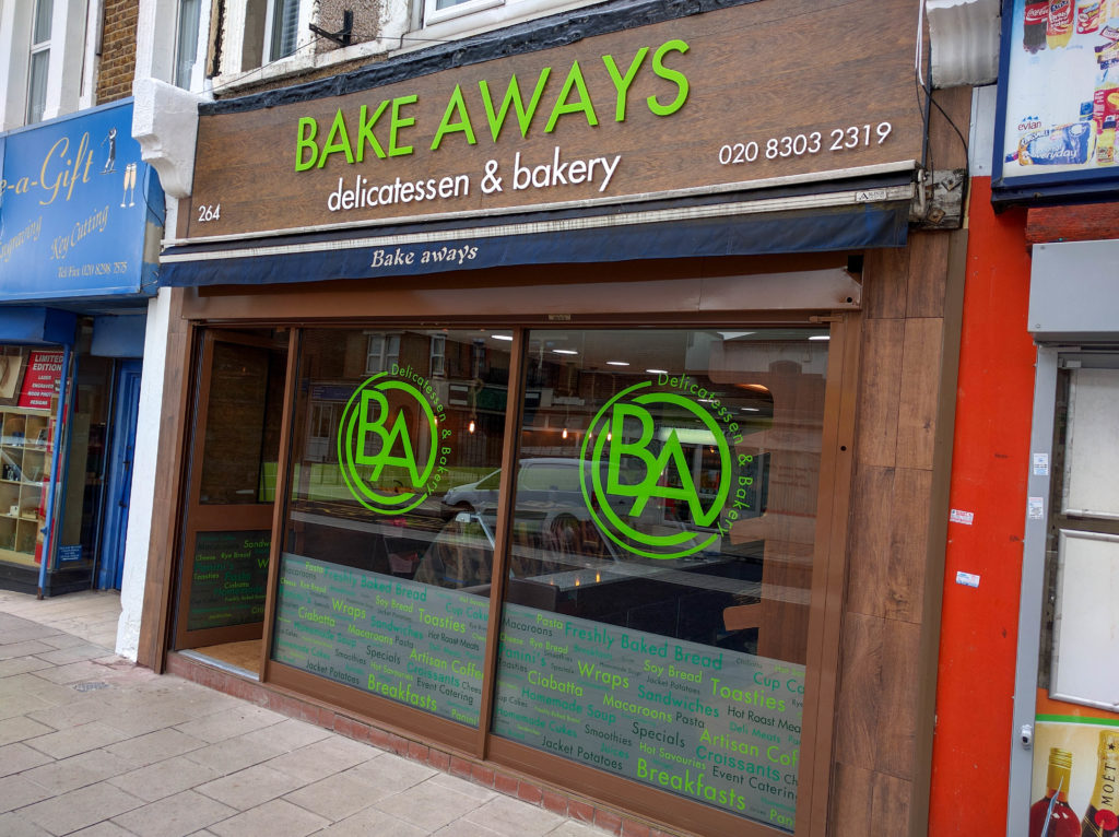 Raised lettering on wood effect sign panel and window graphics